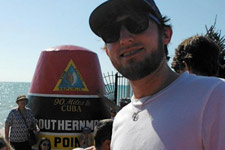 Profile picture of Andrew standing at the Southern-most point in the United States.